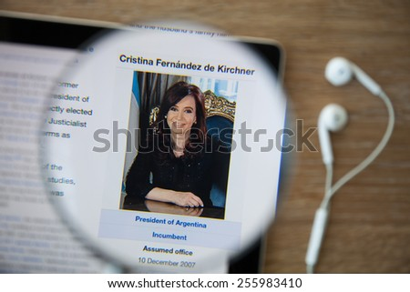 CHIANGMAI, THAILAND - February 26, 2015: Photo of Wikipedia article page about Cristina Fernandez de Kirchner on a monitor screen through a ipad magnifying glass. - stock photo