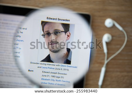 CHIANGMAI, THAILAND - February 26, 2015: Photo of Wikipedia article page about Edward Snowden on a ipad monitor screen through a magnifying glass. - stock photo
