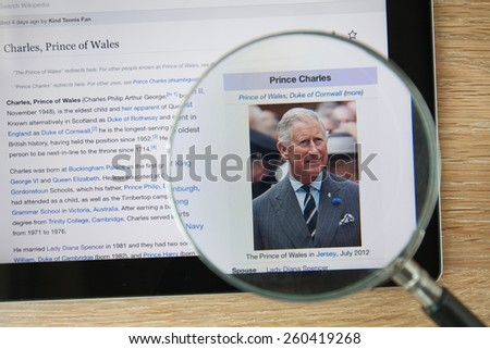 CHIANGMAI, THAILAND - February 26, 2015: Photo of Wikipedia article page about Prince Charles on a ipad monitor screen through a magnifying glass. - stock photo