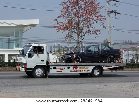 CHIANGMAI , THAILAND -FEBRUARY 16 2015:   Slide up tow truck for emergency car move, TR Slide on Company. Photo at road no.1001 about 8 km from downtown Chiangmai, thailand. - stock photo