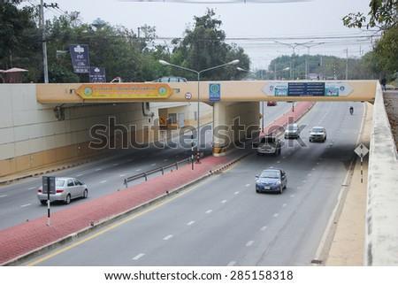 CHIANGMAI, THAILAND- FEBRUARY 11 2015: Tunnel of Road no.3029  middle ring road of Chiangmai city. Chiangmai Province, Thailand. - stock photo