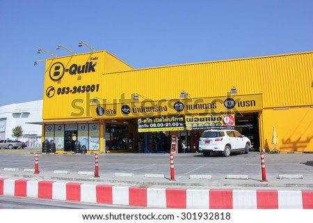 CHIANGMAI , THAILAND -JANUARY 2 2015:  B Quik Shop at Tesco Lotus Ruam Choke. B Quik is Reliable Car Service Center. Location About 5 km from downtown Chiangmai, thailand. - stock photo