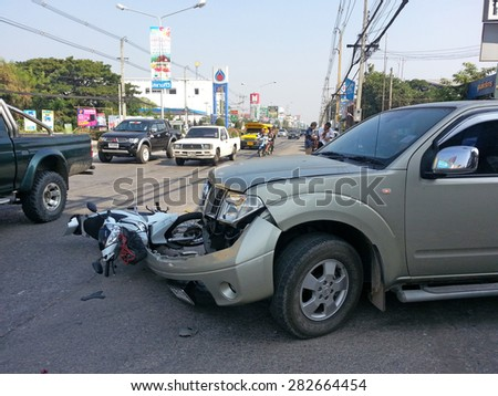 CHIANGMAI, THAILAND - JANUARY 10, 2013: Crash Accident NISSAN FRONTIER NAVARA Pickup Truck with HONDA Motorcycle at roadside in Chiangmai, Northern Thailand. - stock photo