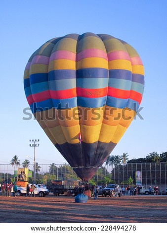 CHIANGMAI, THAILAND -JANUARY 21 2012: Hot air balloon register HS-FLY. Cameron Balloons O-105. Photo in Chiangmai balloon festival, Chiangmai. Thailand.