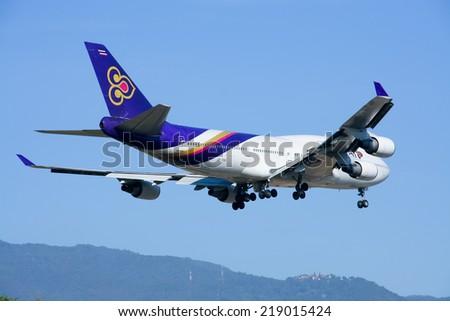 CHIANGMAI , THAILAND-JANUARY 3 2010 : HS-TGK Boeing 747-400 of Thaiairway. Landing to Chiangmai airport from Bangkok Suvarnabhumi. thailand. - stock photo