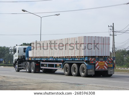 CHIANGMAI, THAILAND -JANUARY 15 2015: Trailer Truck with of Satapornnirattisai transport Company. Photo at road no 1001 about 8 km from downtown Chiangmai, thailand. - stock photo