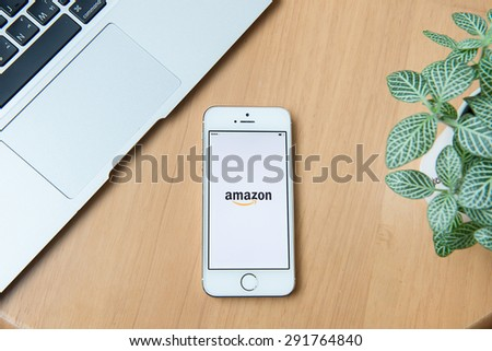 CHIANGMAI,THAILAND - JUNE 24, 2015:Amazon application on Apple iPhone 5S and Macbook display. Amazon is an American international electronic commerce company - stock photo