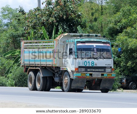 CHIANGMAI , THAILAND -JUNE 19  2015:  Dump truck of Burapha Concrete. Photo at road no.121 about 8 km from downtown Chiangmai, thailand. - stock photo