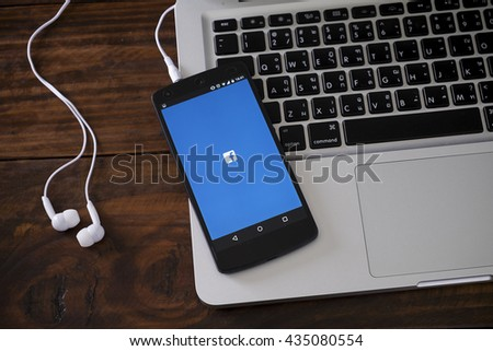CHIANGMAI, THAILAND -JUNE 11, 2016:Facebook page on the smartphone on table. Facebook is very well know social networking service founded in 2004 by Mark Zuckerberg - stock photo