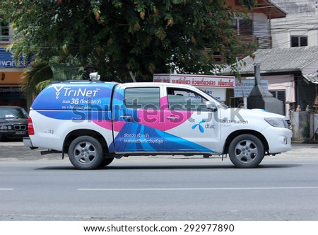 CHIANGMAI , THAILAND -JUNE 30 2015: Pick up truck of Dtac company.Intenet and Mobile phone Service in Thailand. Photo at road no.121 about 8 km from downtown Chiangmai, thailand. - stock photo