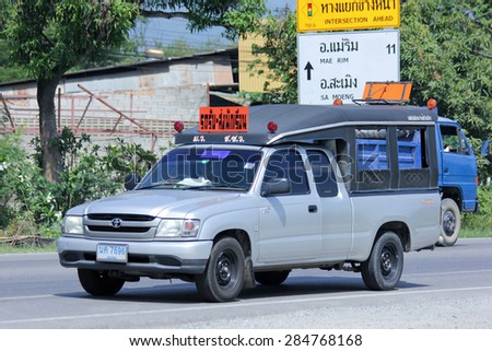 CHIANGMAI , THAILAND -JUNE 3 2015:   Private School pickup. Photo at road no.121 about 8 km from downtown Chiangmai, thailand. - stock photo