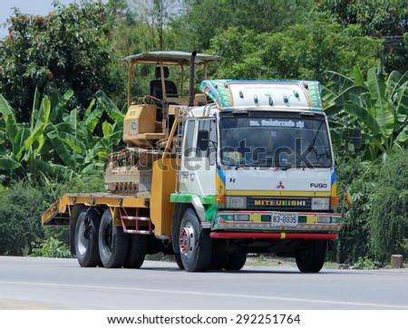 CHIANGMAI , THAILAND -JUNE 29 2015: Truck and backhoe of Norst Star Group. Photo at road no.121 about 8 km from downtown Chiangmai, thailand.