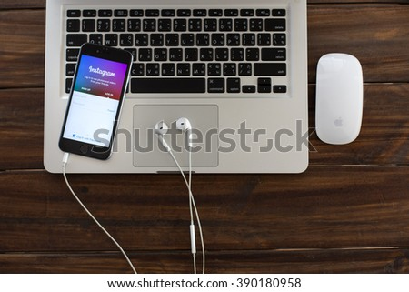 CHIANGMAI, THAILAND - MARCH 12, 2016:Apple iphone 6 displaying Instagram page on new iphone 5s. The photo-sharing social network, which has 150 million monthly active users. - stock photo