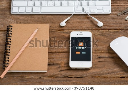 CHIANGMAI, THAILAND -MARCH 31, 2016:Brand Apple iPhone 4s with Blogger is a free weblog publishing tool from Google, for sharing text, photos and video. - stock photo
