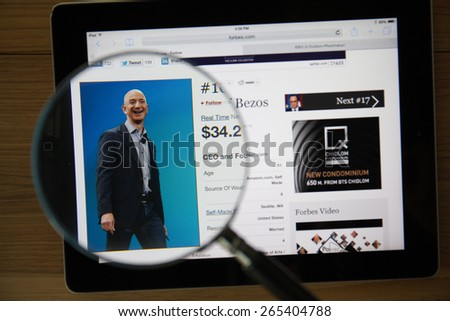 CHIANGMAI, THAILAND - March 31, 2015: Photo of Forbes article page about Jeff Bezos on a ipad monitor screen through a magnifying glass.