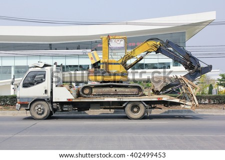 CHIANGMAI, THAILAND -MARCH 3 2016:  Private Truck and backhoe. On road no.1001, 8 km from Chiangmai city.