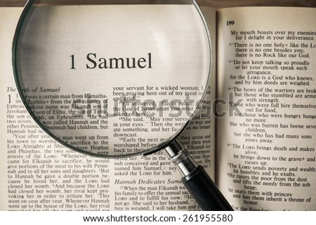 "CHIANGMAI, THAILAND, March 17,2015. Reading The New International Version of the Holy Bible on the book of "" samuel "" at home. March 17,2015"