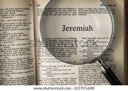 "CHIANGMAI, THAILAND, March 17,2015. Reading The New International Version of the Holy Bible on the book of "" jeremiah "" at home. March 17,2015"