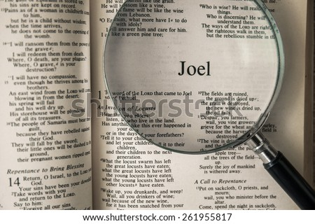 "CHIANGMAI, THAILAND, March 17,2015. Reading The New International Version of the Holy Bible on the book of "" joel "" at home. March 17,2015"