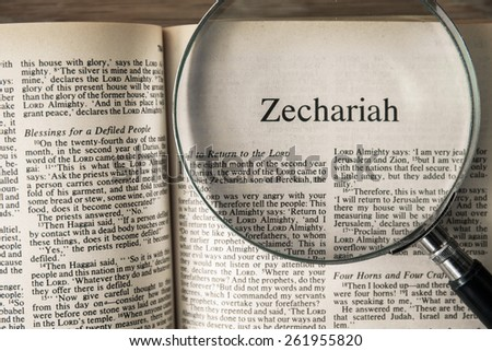 "CHIANGMAI, THAILAND, March 17,2015. Reading The New International Version of the Holy Bible on the book of "" zechariah "" at home. March 17,2015"