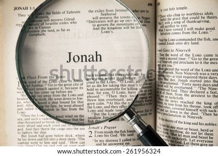 "CHIANGMAI, THAILAND, March 17,2015. Reading The New International Version of the Holy Bible on the book of "" jonah "" at home. March 17,2015"