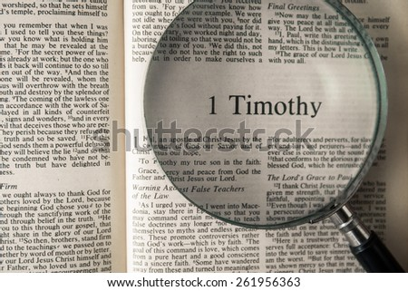 "CHIANGMAI, THAILAND, March 17,2015. Reading The New International Version of the Holy Bible on the book of "" timothy "" at home. March 17,2015"