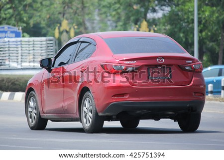 CHIANGMAI, THAILAND -MAY 2 2016:   Private Eco car, Mazda2. Photo at road no 121 about 8 km from downtown Chiangmai, thailand.