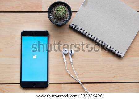 """CHIANGMAI, THAILAND -NOV 2,2015:Apple iPhone 6 plus open Twitter application,Twitter is an online social networking and microblogging service that enables users to send and read """"tweets"""" - stock photo"""