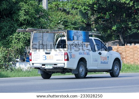 CHIANGMAI , THAILAND -NOVEMBER 20 2014:   Mini truck of Triple T Broadband company. Intenet  Service in Thailand. Photo at road no 121 about 8 km from downtown Chiangmai, thailand. - stock photo