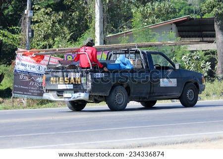 CHIANGMAI, THAILAND - NOVEMBER 27 2014: Mini truck of True company. Intenet  Service in Thailand. Photo at road no 121 about 8 km from downtown Chiangmai, thailand. - stock photo