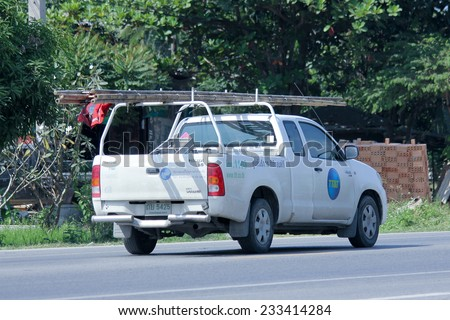 CHIANGMAI , THAILAND -NOVEMBER 21 2014:  Mini truck of TT&T company. Intenet and Telephone Service in Thailand. Photo at road no 121 about 8 km from downtown Chiangmai, thailand. - stock photo