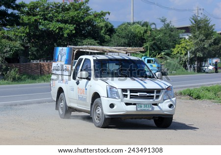 CHIANGMAI, THAILAND - NOVEMBER 11 2014:  Pickup truck of Triple T Broadband company. Intenet Service in Thailand. Photo at road no 121 about 8 km from downtown Chiangmai, thailand. - stock photo