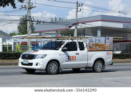 CHIANGMAI, THAILAND -NOVEMBER  2 2015: Pickup truck of Triple T Broadband company. Intenet Service in Thailand. Photo at road no 121 about 8 km from downtown Chiangmai, thailand. - stock photo