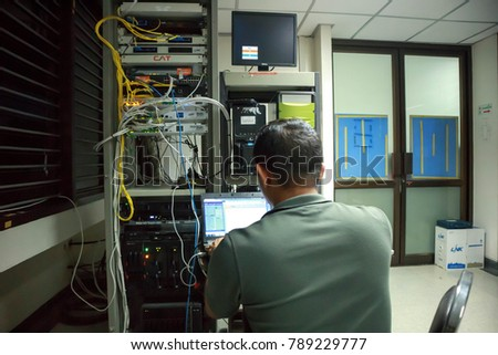 Chiangmai-Thailand. November,21,2017. Team of technicians working together on servers in data centre at the  Rajanagarindra Institute of Child Development Chiang Mai.