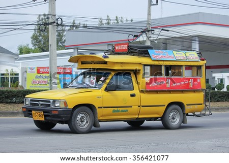 CHIANGMAI, THAILAND -NOVEMBER  3 2015:  Yellow Pick up truck taxi chiangmai, Service between city and Jpm Thong. Photo at road no 121 about 8 km from downtown Chiangmai, thailand.