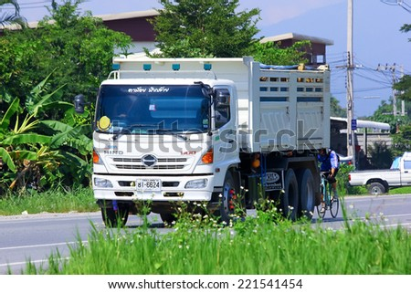 Chiangmai, Thailand - October 3, 2014: Hino Dump truck of Payawan company. Photo at road no 121 about 8 km from downtown Chiangmai, thailand.
