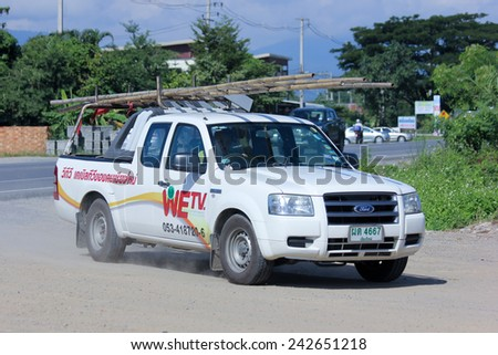 CHIANGMAI, THAILAND - OCTOBER 30 2014:  Mini truck of We TV company. Cable TV Service in Urban of Chiangmai area. Photo at road no 121 about 8 km from downtown Chiangmai, thailand. - stock photo