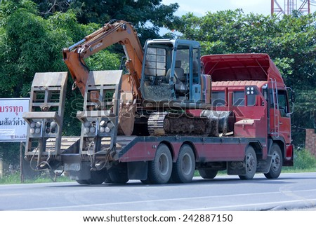CHIANGMAI, THAILAND - OCTOBER 31 2014:   Private truck and backhoe. Photo at road no.121 about 8 km from downtown Chiangmai, thailand.