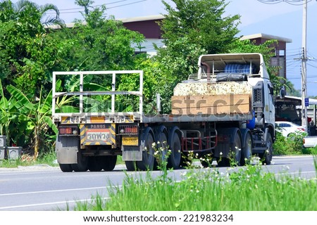 CHIANGMAI, THAILAND - OCTOBER 3 2014: Trailer Truck of Anake transport company. Photo at road no.121 about 8 km from downtown Chiangmai, thailand.