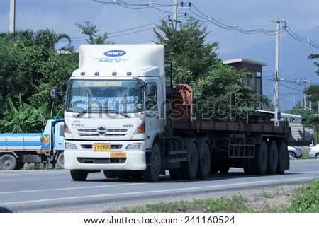 CHIANGMAI, THAILAND -OCTOBER 25 2014: Trailer Truck of MMT Logistic transport company. Photo at road no.121 about 8 km from downtown Chiangmai, thailand. - stock photo