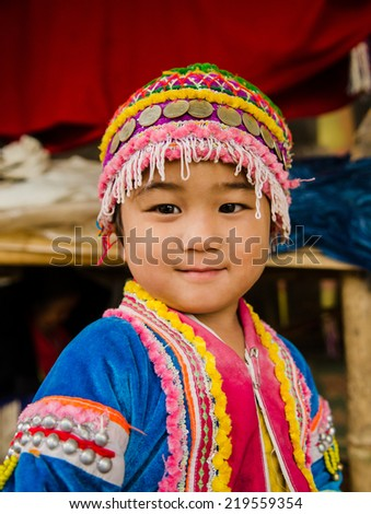 CHIANGMAI,THAILAND - SEP 17, 2014: Unidentified Palaung kid in the Palaung traditional costume poses for the camera. Palaung people is a minority ethnic group living in northern Thailand