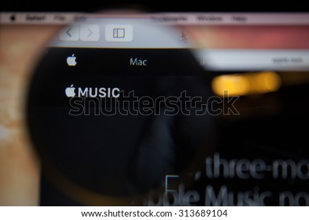CHIANGMAI, THAILAND - SEPTEMBER 6, 2015:Photo of Apple Music homepage on a monitor screen through a magnifying glass.