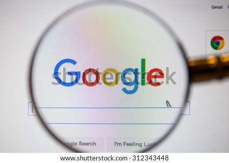 CHIANGMAI, THAILAND - September 1, 2015:Photo of new logo of Google homepage on a monitor screen through a magnifying glass. - stock photo