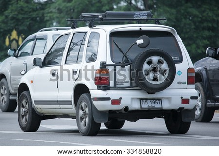 CHIANGMAI, THAILAND -SEPTEMBER  8 2015:   Private MPV Car, Kia Sportage. Photo at road no.121 about 8 km from downtown Chiangmai, thailand.