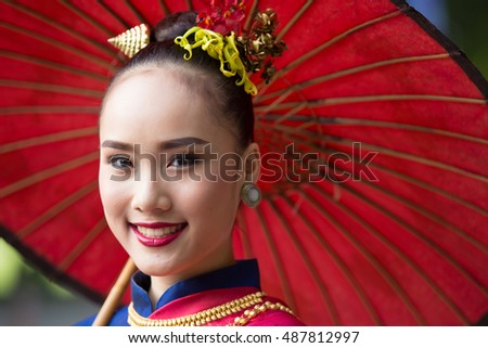 CHIANGMAI, THAILAND - SEPTEMBER 10: Unidentified Thai lanna traditionally dressed women on the parade in Chiang Mai University Trekking Festival 2016 on September 10, 2016 in Chiang Mai, Thailand.