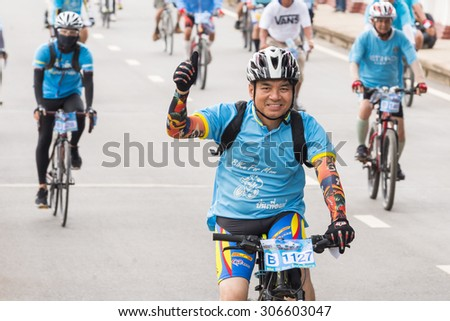 CHIANGRAI, THAILAND 16 AUGUST 2015 : bike for mom event, shot of a man giving a thumb's up at the bike parade