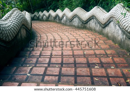 CHIANGRAI,THAILAND-AUGUST 31,2015 : Staircase on  Wat Phra That Doi Tung. this temple has a stupa reputed to contain the Buddha's collarbone, Located Chiangrai Province in Northern of Thailand. - stock photo