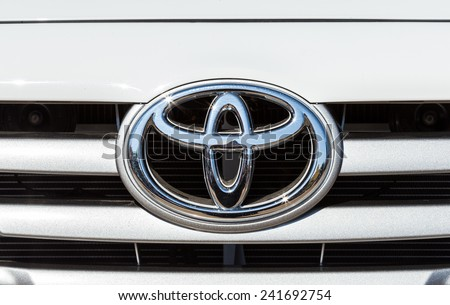 CHIANGRAI, THAILAND - DECEMBER 31, 2014 : Logo of Toyota car on display at Chiang Rai ASEAN flower festival 2014