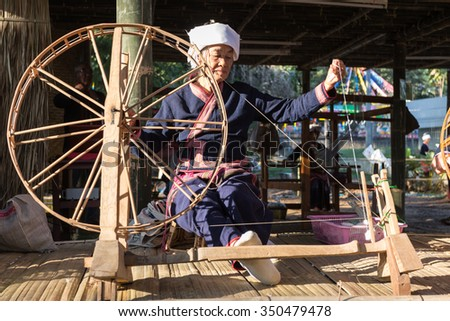 CHIANGRAI -THAILAND DECEMBER 7: Unidentified Tai Lue (ethnic group living in parts Thailand) in Tribal dress show weaving and spin cotton thread at on December 7, 2015 in Chiangrai,Thailand - stock photo
