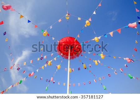 CHIANGRAI,THAILAND - JANUARY 1 : The big red umbrella with national flags of Southeast asia countries, AEC, ASEAN Economic Community in public park on January 1, 2016 in Chiangrai,Thailand